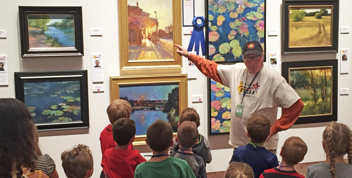 Artist Mark Akins of Colorado leads a kids' artwalk during Art in the Afternoon
